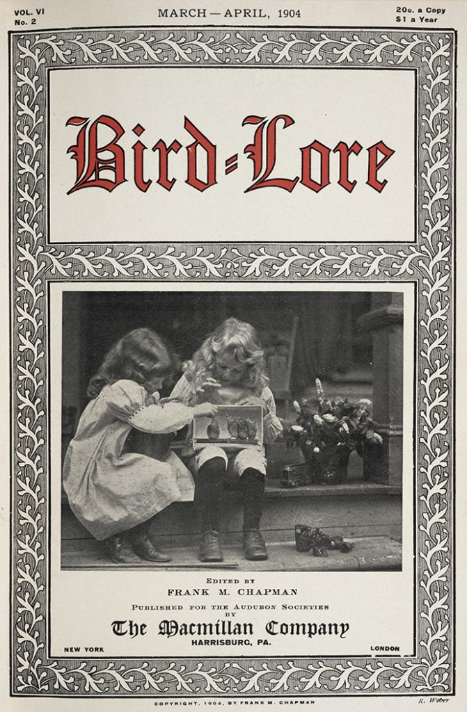 cover of Bird-Lore featuring 2 small girls playing with a bird in a cage