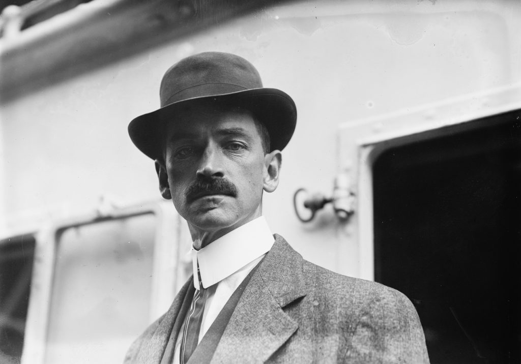 Portait of Glenn Curtiss in front of a train