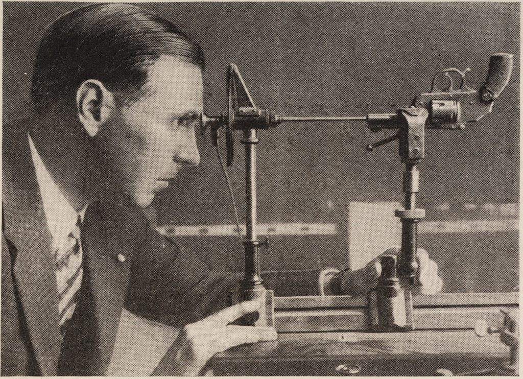 Calvin Goddard examines a revolver using a helixometer