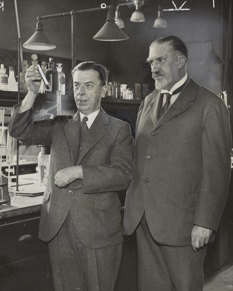 Dr. Alexander Gettler (left) in his laboratory with Dr. Charles Norris